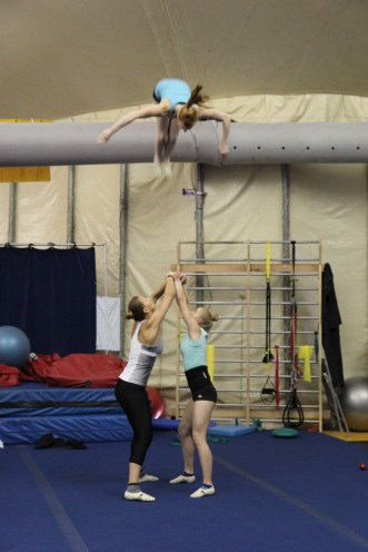 Three Cirque du Soleil gymnasts in training